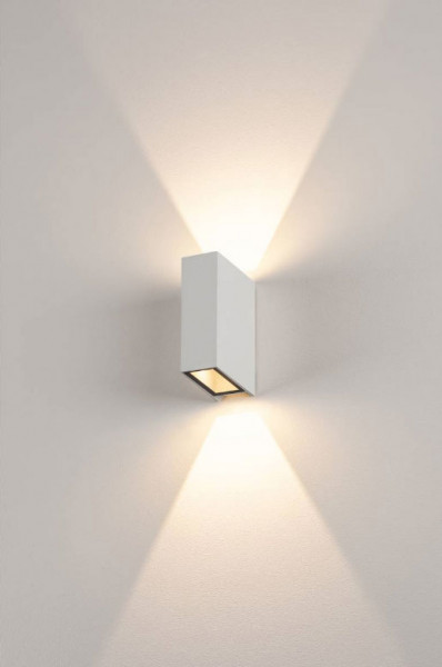 Narrow LED wall spotlight with white surface, double-sided for indoor and outdoor use