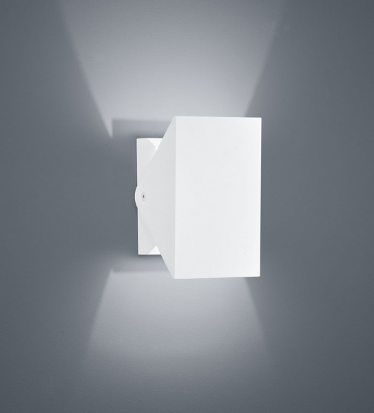 Swiveling ceiling and wall spotlight for outdoor applications with a white surface