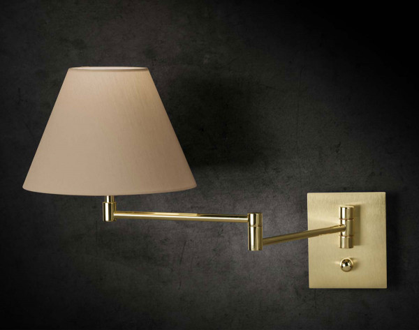Wall lamp by Holtkötter - here the variant in metal surface polished brass / brass matt with fabric shade Chintz in color sand