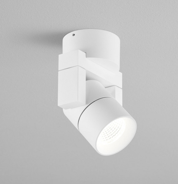 Swiveling wall and ceiling spotlight for outdoor applications in white surface