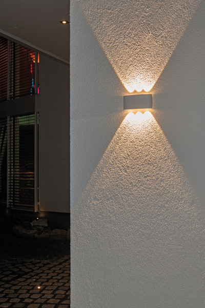 LED wall light with lens technology that generates sharply focused light beams