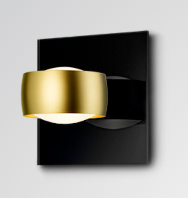 Wall lamp GRACE UNLIMITED by Oligo with head in gold matt - here with optional black glass plate